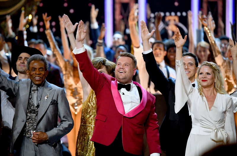 Host James Corden (C) performs onstage during the 73rd Annual Tony Awards.