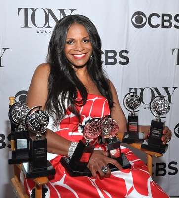 Audra McDonald, posing backstage at the 2014 Tony Awards with 6 Tony medallions. She is the first person in history to have won 6 competitive Tony Awards as a performer.