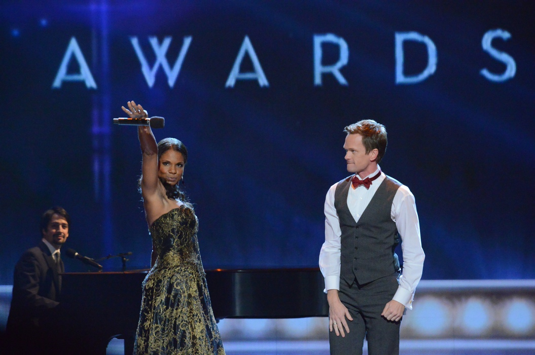 Audra McDonald (left) and Host Neil Patrick Harris perform at the finale of the 2013 Tony Awards, accompanied by Lin-Manuel Miranda.