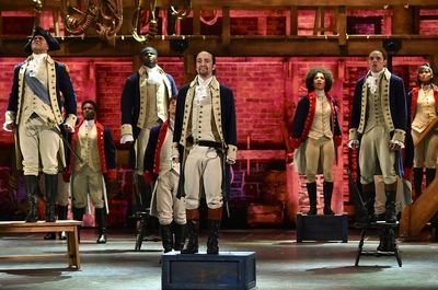 Lin-Manuel Miranda (center) and the company of 'Hamilton' performs onstage during the 70th Annual Tony Awards at The Beacon Theatre.
